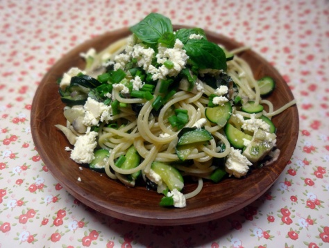 Spaghetti with zucchini, mushrooms, herbs and feta cheese