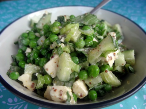 Salad with peas, cucumber, pak choi, feta cheese and yogurt dressing