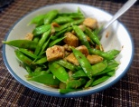 Snow peas salad with tofu and soy sauce sesame dressing