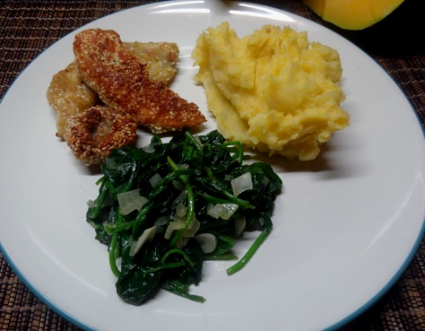 Chicken fillet and mushrooms in pesto sesame crust with mashed potatoes and baby spinach