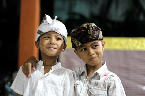 Two boys at a ceremony in Bali. Kids being kids Location: Berawa, Canggu