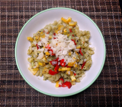 Elbow macaroni with pesto, peperoni and yellow zucchini