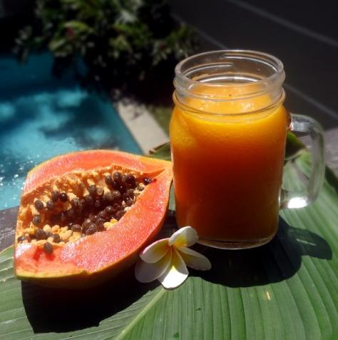 Smoothie with papaya, mango, vanilla and curcuma
