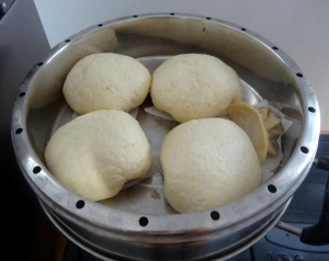 Chicken buns in steamer