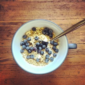 Coconut yogurt with cereals and fresh blueberries